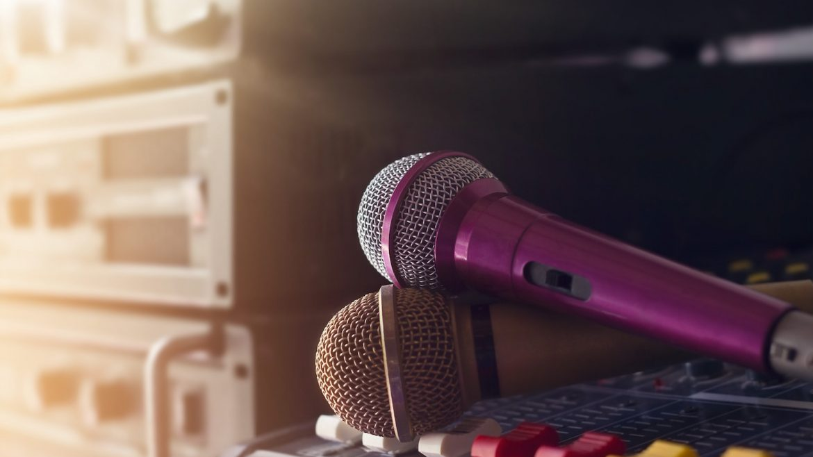 Two microphone on sound control in backstage of concert